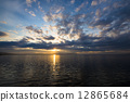 The sunset of Lake Saroma and the cloud weaving 12865684
