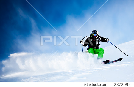 Stock Photo: Man27;s skiing downhill in fresh snow. West Alps, Italy