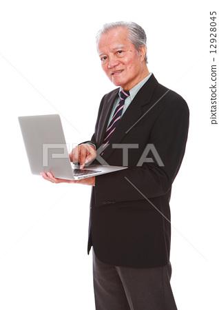 white background,old man, studio shot, businessman, portrait, suit, senior, formal, office, laptop   12928045