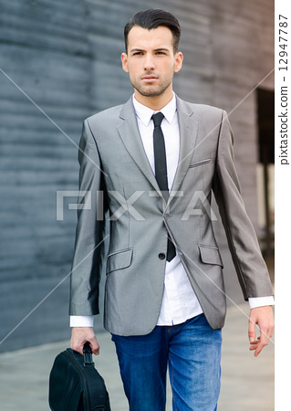 Young businessman near a office building 12947787