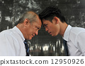 Profile of two Asia white collar men facing off each other with the foreheads locking together 12950926