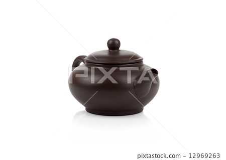 Traditional asian clay teapot isolated 12969263