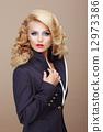 Charisma. Businesslike Woman Blonde in Blue Suit 12973386