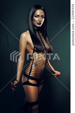 naked woman in costume with whip 12996498