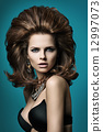 Elegant woman with luxuriant hair 12997073