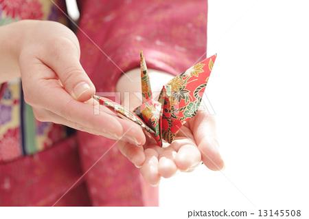 A woman wearing a kimono with folded crane 13145508