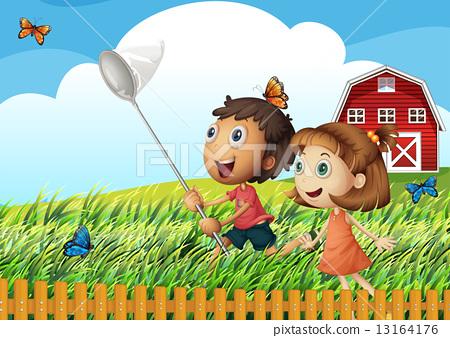 Kids catching butterflies at the field 13164176