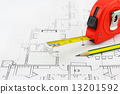 Tape measure and pencil over a construction plan drawing 13201592