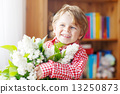 Adorable little toddler boy with blooming white lilac flower 13250873
