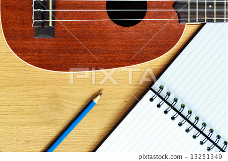 ukulele guitar with  notebook and pencil 13251349