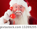 Composite image of santa on his red phone 13269205