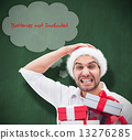 Composite image of festive man holding christmas gifts 13276285