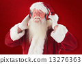 Composite image of santa claus enjoys some music 13276363