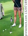 Attractive golfer girl 13297189