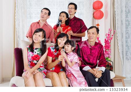 Chinese family singing Karaoke celebrating Chinese new year 13323934