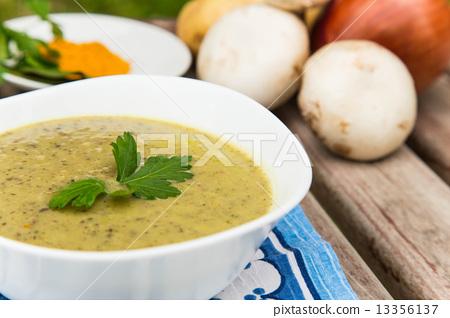 Mushroom cream soup in the white plate 13356137