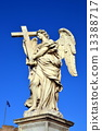 Sculpture of an angel with cross on Ponte Sant'Angelo, Rome, Italy. The bridge was built in 1450 13388717