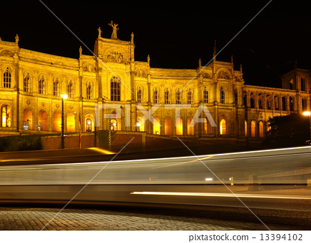 Munich - Maximilianeum at night with rays from a street car 13394102