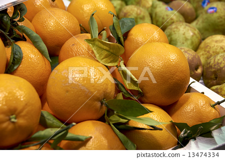 Juicy ripe oranges on the counter 13474334