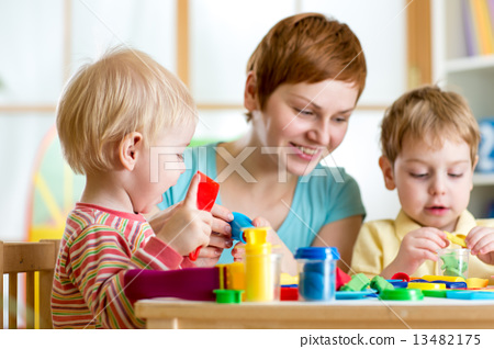 kids or children and mother play colorful clay toy 13482175