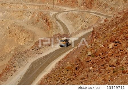 huge trucks work in a quarry mining 13529711