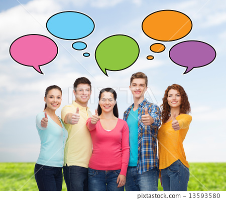 Stock Photo: group of smiling teenagers showing thumbs up