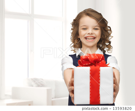 Stock Photo: happy smiling girl with gift box