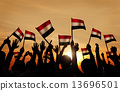 Silhouettes of People Holding the Flag of India 13696501