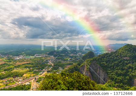 Beautiful landscape with a rainbow in the sky 13712666