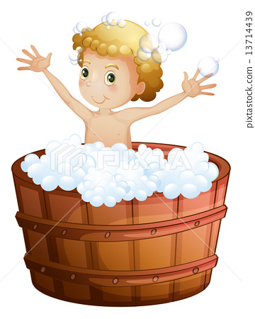 A young boy taking a bath 13714439