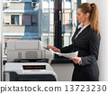 business woman working on printer 13723230