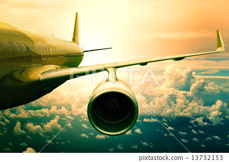Stock Photo: passenger jet plane flyin above cloud scape use for aircraft tra