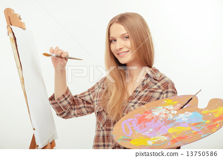 Stock Photo: Young beautiful artist creating a masterpiece