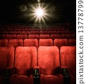 Empty comfortable red seats with numbers in cinema 13778799
