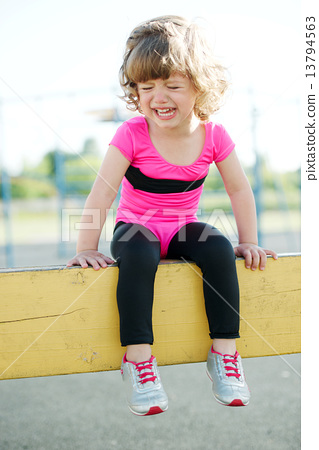 unhappy girl crying on the playground 13794563