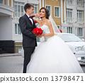 Newlyweds near the house 13798471