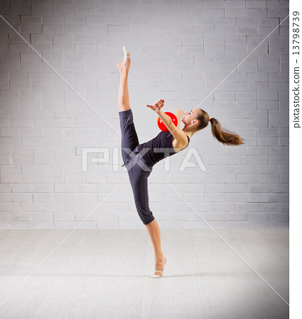 Girl is engaged in art gymnastics 13798739