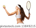 Adult woman playing tennis.  13849215