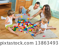 Family of four at home with toys 13863493