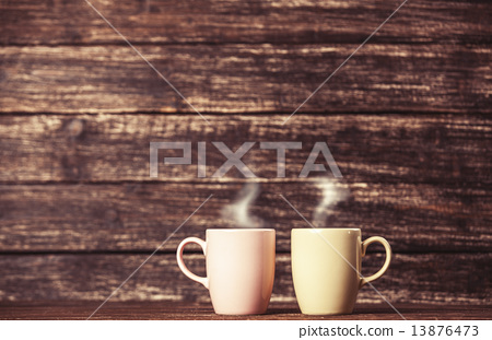 Stock Photo: Two cups of coffee on wooden table.