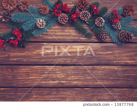 pine branches on a wooden table. 13877768