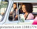Hipster couple driving in camper van 13881774