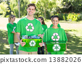 Happy environmental activists in the park with recyclables 13882026