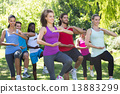 Fitness group doing tai chi in park 13883299