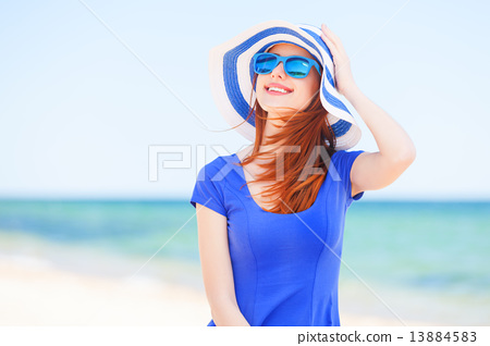 Stock Photo: Redhead girl on the beach in spring time.