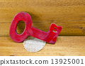 Red wooden vintage key on wooden surface 13925001
