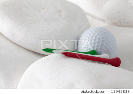 Golf ball and tees between white stones 13943838