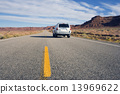 Silver SUV driving in Utah. 13969622