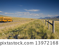 Blurred school bus on the road 13972168