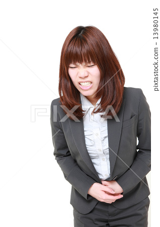 Business woman panting for abdominal pain 13980145